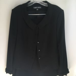 Black skirt and jacket suit, ruffle trim accent